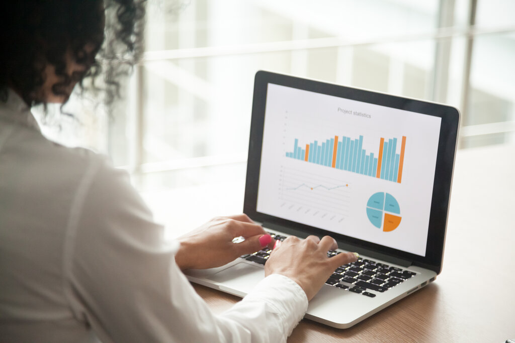 female eCommerce manager looks at bar and pie graphs online